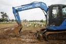 FOTO Pemakaman Jenazah Covid-19 di TPU Srengseng Sawah 2